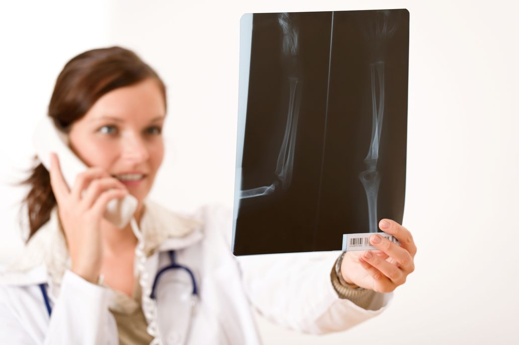 female doctor on phone with xray